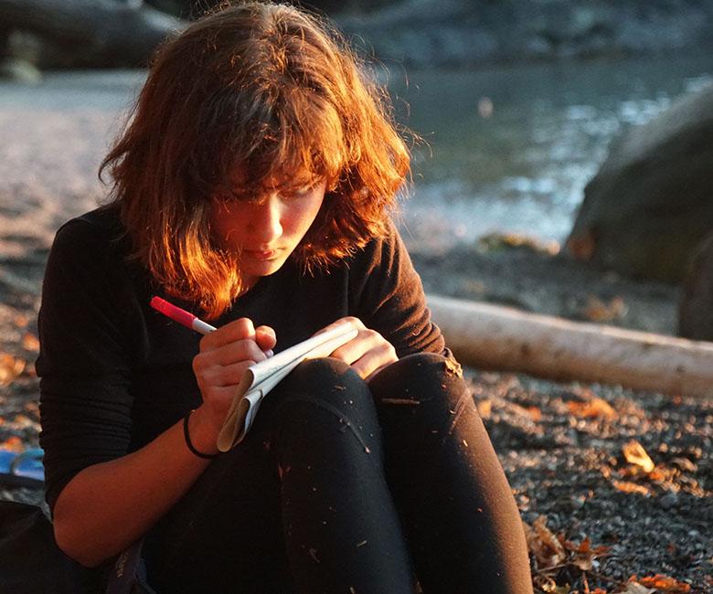 Girl Writing cliffside